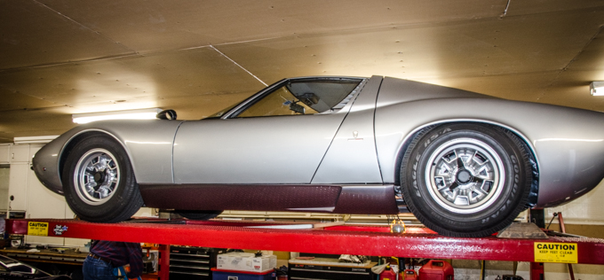 The Miura rests in Scott's residential garage
