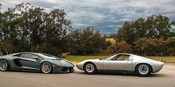 The old and the new.  Scott's Lamborghini on the right, overshadowing a new Lambo Aventador on the left